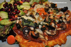 cauliflower pizza and salad