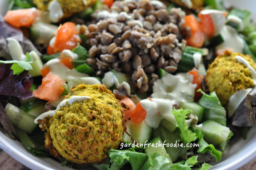Fresh Salad Topped With Falafel, Lentils, and Tahini