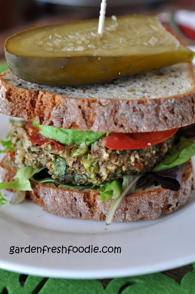 Cauliflower Veggie Burger Topped With Avocado, Tomato, Lettuce, and A Garlicky Dill Pickle