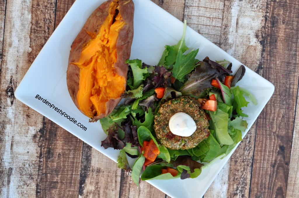 Cauliflower Veggie Burger With Salad and Topped With Cashew Cream