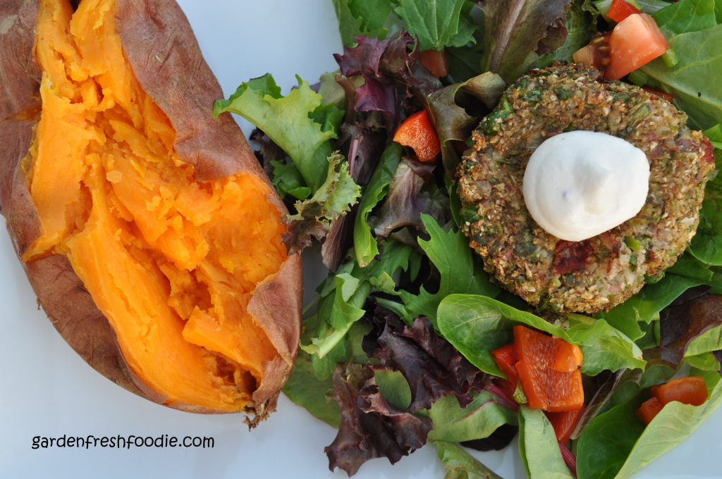 Grain Free Cauliflower Burger Atop Salad Served With Baked Sweet Potato