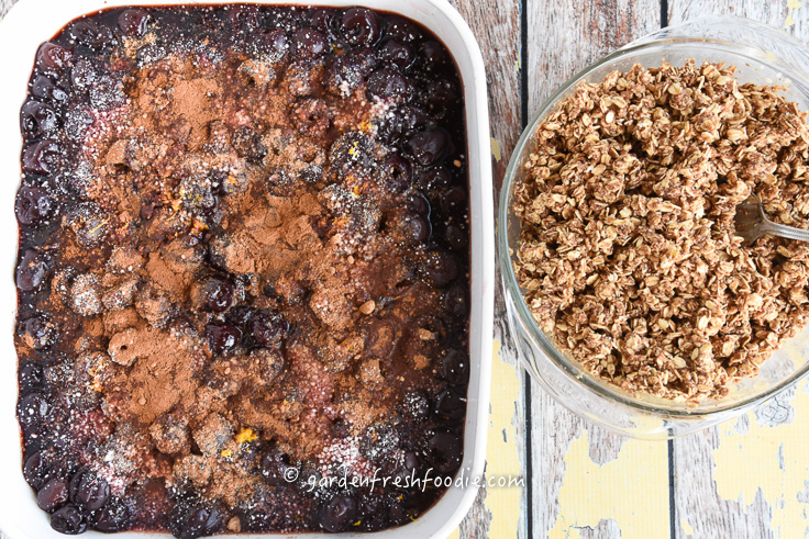 Mixing Filling For Cherry Cobbler With Oat Topping