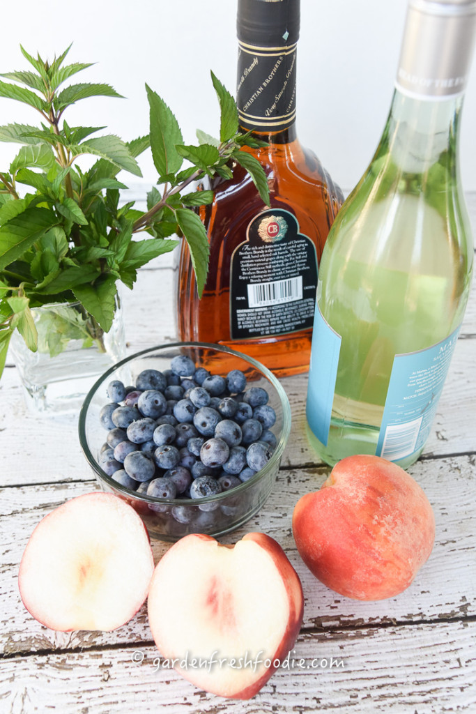 White Wine Sangria With Fresh Peaches, Mint, and Blueberries Mise En Place