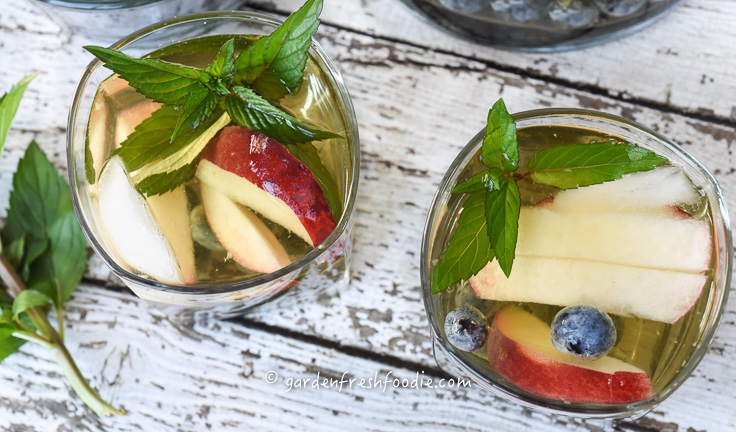 White Wine Sangria With Fresh Peaches, Mint, and Blueberries