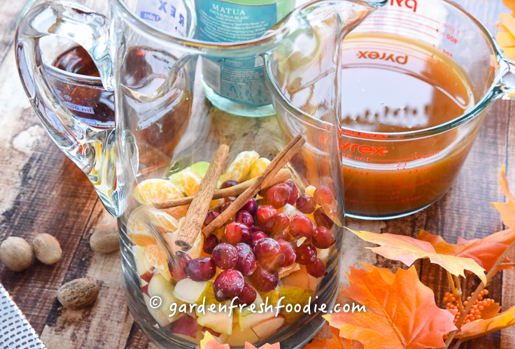 Placing Fruit For Apple Cider Sangria